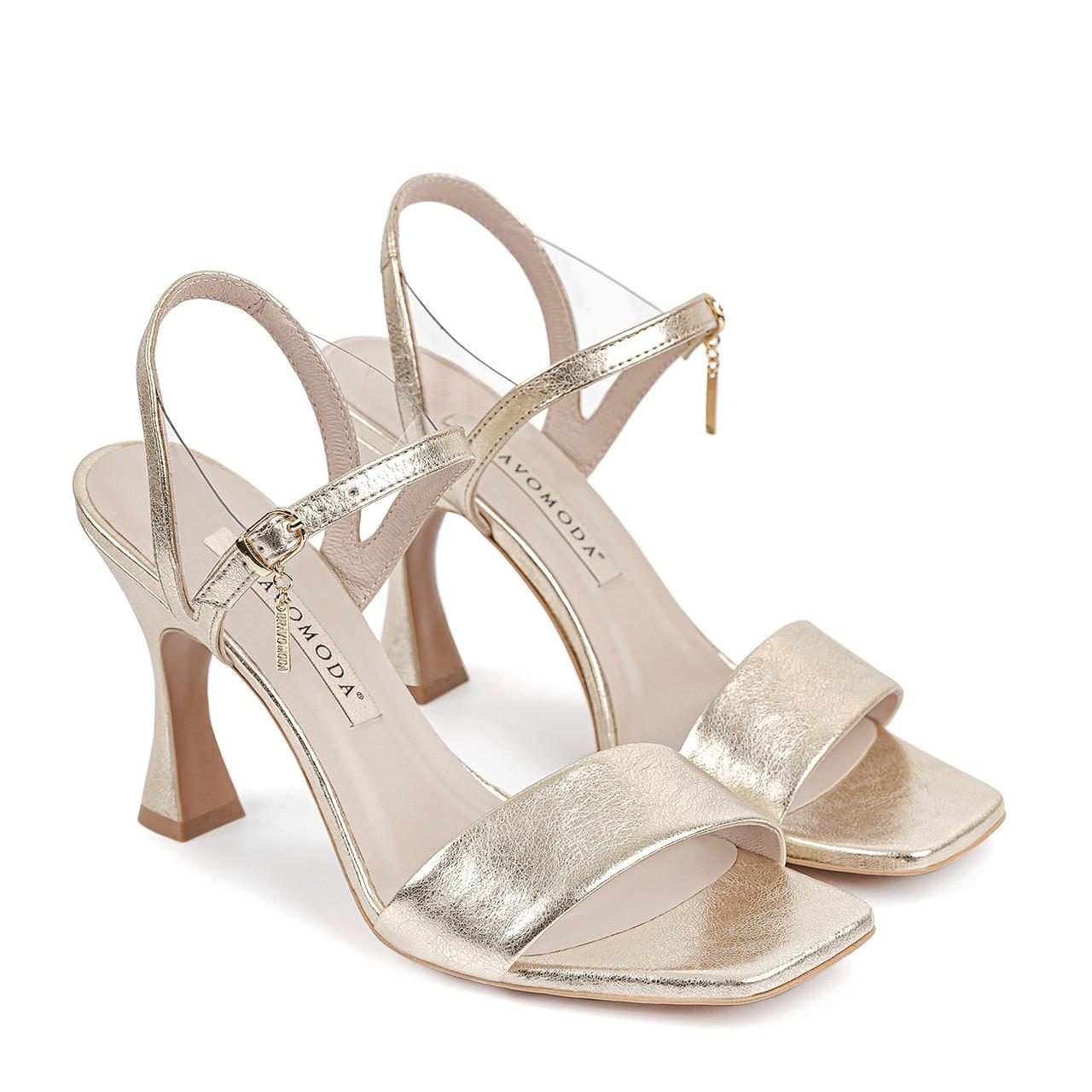 Złote skórzane sandały na ciekawym, wysokim obcasie